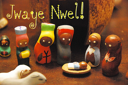 ZP_A toy Nativity scene with a coconut shell as the stable, from Haiti. Jwaye Noel means Merry Christmas in Haitian Creole._Jwaye Nwel dice Feliz Navidad en el idioma criollo haitiano.
