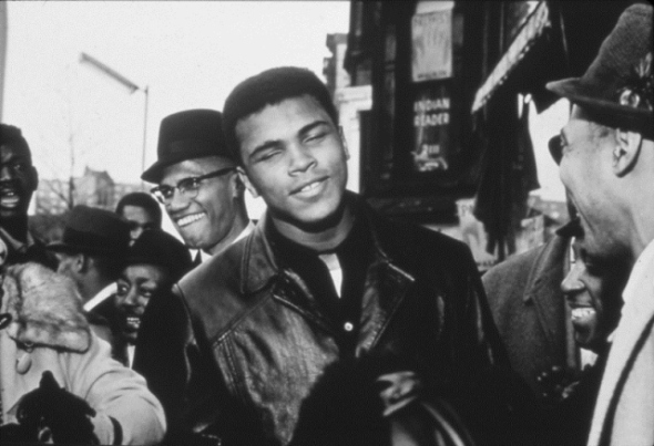 ZP_Muhammad Ali with Malcolm X in the background_1964 photograph by Robert L. Haggins