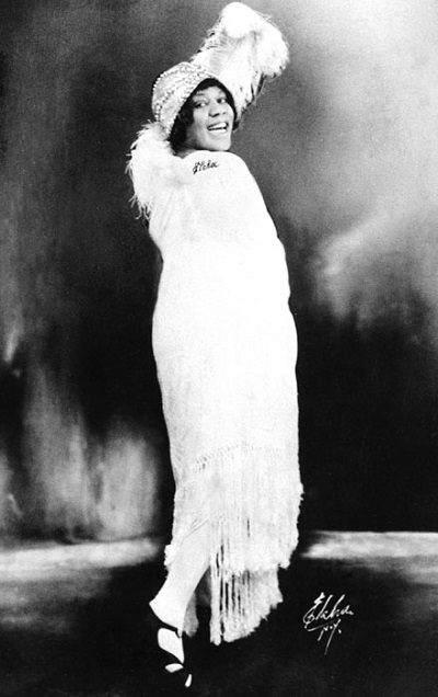ZP_Bessie Smith, 1894 to 1937, was the biggest Blues singer of the 1920s.  Poet Langston Hughes would've been familiar with her spicy lyrics.