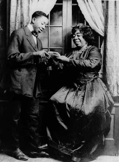 ZP_Gertrude Ma Rainey, 1886 to 1939, and a Suitor, in The Rabbit Foot's Minstrels touring music and theatre company, around 1915_Rainey was one of the earliest Blues singers and among the first to record.