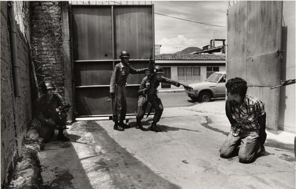 Arrest of an autorepair mechanic for failure to carry an ID card_San Salvador_early 1980s_photograph copyright John Hoagland