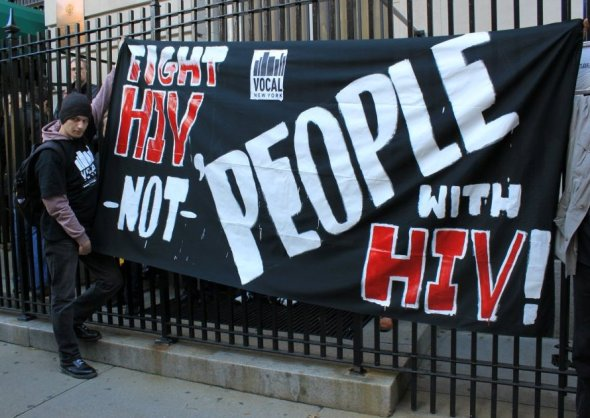 Fight HIV not People with HIV! Activist with banner outside the Russian Embassy in New York City_2013
