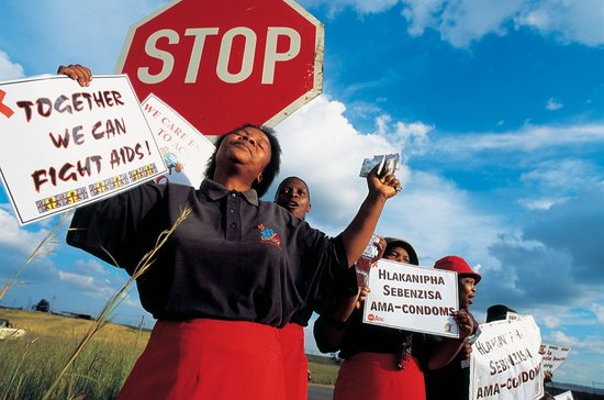 South African women reminding passing motorists that condom use drastically reduces the spread of HIV_2009