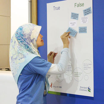 Standard Chartered Bank in Brunei Darussalam on the island of Borneo conducted a Living With HIV morning huddle with its staff. True or False statement cards were used to test staff's knowledge of HIV facts_October 2013