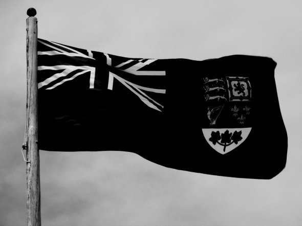 ZP_The Canadian Red Ensign flag in a black and white photo