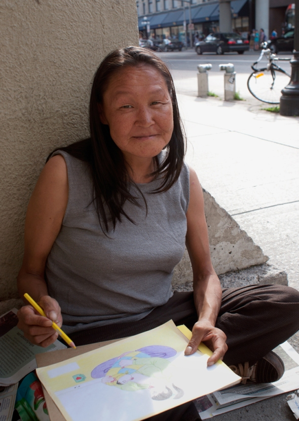 Annie Pootoogook outside the Rideau Centre in Ottawa making a drawing with coloured pencils_Summer of 2012