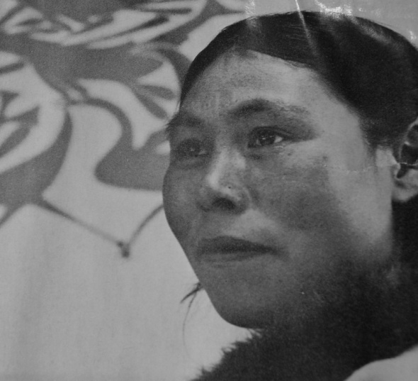 Kenojuak photographed in 1963 in front of one of her prints