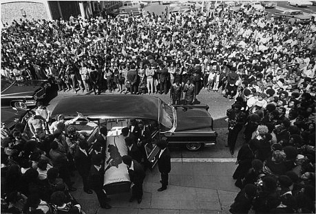 Crowd outside in Oakland, California, when  George Jackson's coffin was being brought into St. Augustine's Church_photograph by Stephen Shames_August 1971