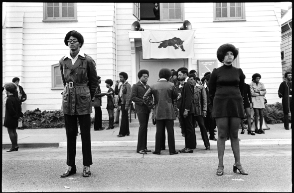 Glen Wheeler and Claudia Grayson, known as Sister Sheeba, stand outside George Jackson's funeral at St. Augustine's Church in Oakland, California_August 1971