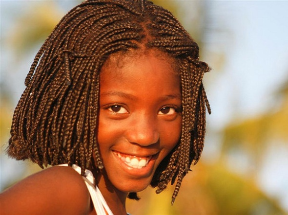 A lovely hairstyle on this young girl highlights her smile