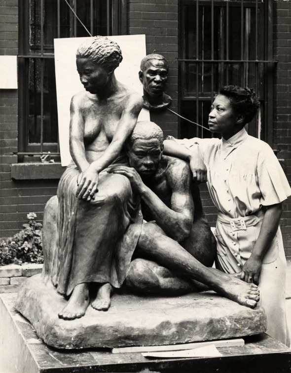 Augusta Savage with one of her sculptures_around 1938