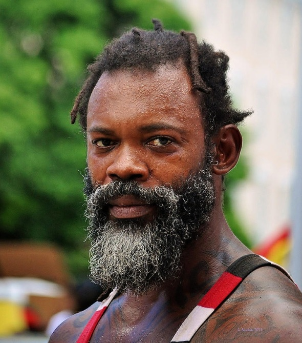 Middle aged Rastafarian man_photograph by L New ton