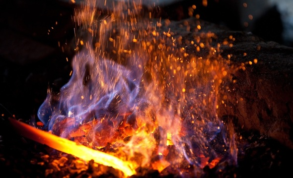 A blacksmith's forge with an iron in the fire_photograph copyright Sergey Dolya
