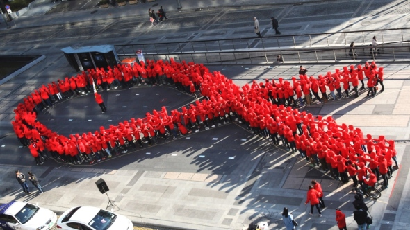 World AIDS Day 2013_highschool students in Seoul South Korea form themselves into the red ribbon universal symbol of AIDS Awareness_December 1st 2013