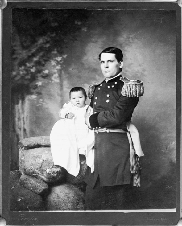 1891 Portrait of General L.W. Colby of Nebraska State Troops, holding baby girl Zintkala Nuni (Little Lost Bird), found on the Wounded Knee battlefield_This photograph is part of the long official history of the sentimentalization of Native genocide in the U.S.A.