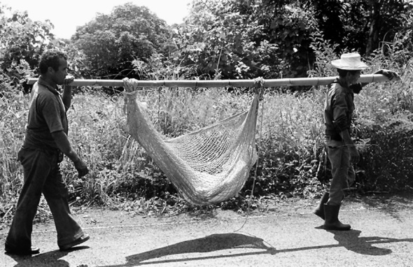 Gary Mark Smith_1982 photograph of a victim of the civil war in El Salvador being carried home for burial_wrapped up in a hammock