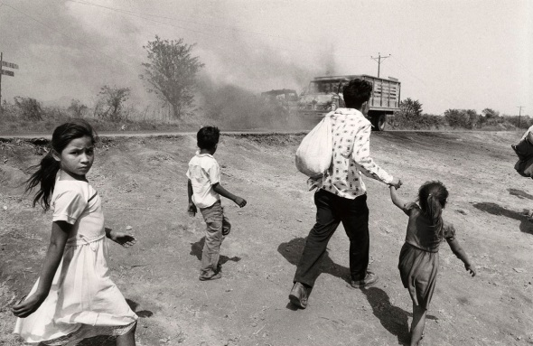 John Hoagland_photograph from the early 1980s in Usulután El Salvador_Civilians fleeing...