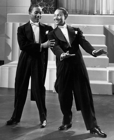 Fayard and Howard_The Nicholas Brothers_seen in a still from the motion picture Stormy Weather 1943