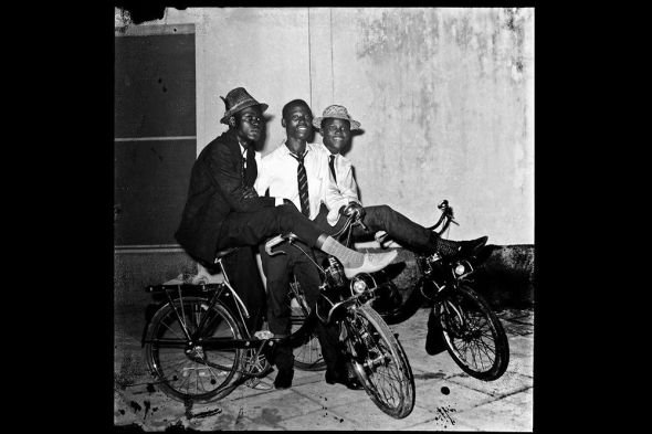 Off-duty soldiers on bikes